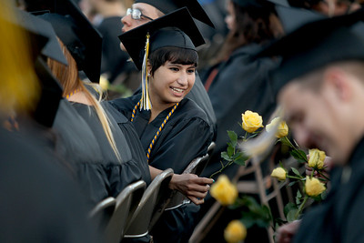 Sarah Nader - snader@shawmedia.com Graduate Jacqueline Jimenez sits with her classmates after receiving her diploma during Harvard High School's 2013 Commencement on Tuesday, May 21, 2013.