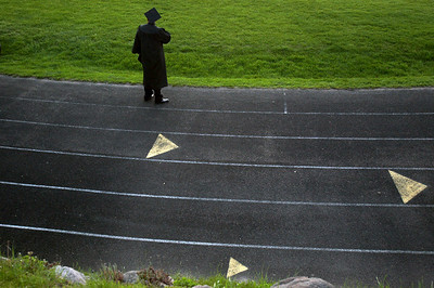 Sarah Nader - snader@shawmedia.com Graduate Victor Saucedo looks back at the football field after Harvard High School's 2013 Commencement on Tuesday, May 21, 2013.