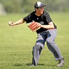 Kaneland pitcher Anthony Holubecki throws to first during practice Monday afternoon.