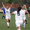 Jeff Krage – For Shaw Media<br /> St. Charles East's Amanda Hilton, left, and Darcy Cunningham, right, celebrate after Carly Pottle's goal in the second half of Saturday's regional championship against Geneva at Streamwood High School. The goal cut the Saints deficit to 2-1.<br /> Streamwood 5/18/13