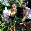 Theresa Jaeger (center) and Julie Brown look over Jaeger's garden, which will be featured during the Geneva Garden Club's biennial Garden Walk June 14 and 15.