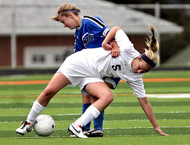 Monica Maschak - mmaschak@shawmedia.com Cassie Warton gets pulled to the ground during the Class 2A Freeport Sectional semifinals in Freeport, Ill., Tuesday, May 22, 2013. Prairie Ridge shut out Rosary 3-0.