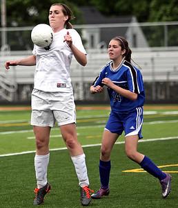 Monica Maschak - mmaschak@shawmedia.com Kelsey Bear chest bumps the ball during the Class 2A Freeport Sectional semifinals in Freeport, Ill., Tuesday, May 22, 2013. Prairie Ridge shut out Rosary 3-0.
