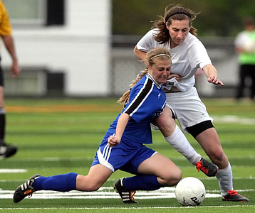 Monica Maschak - mmaschak@shawmedia.com Kelsey Bear attempts to kick over her fallen opponent during the Class 2A Freeport Sectional semifinals in Freeport, Ill., Tuesday, May 22, 2013. Prairie Ridge shut out Rosary 3-0.