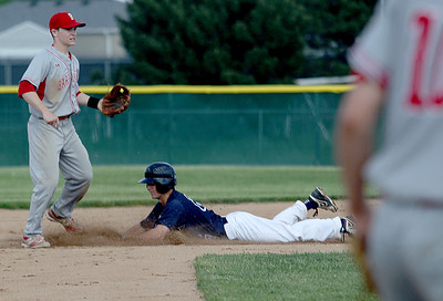 Sarah Nader - snader@shawmedia.com Barrington's Dylan Lidge (left) waits for the pass while Cary-Grove's Matt Sutherland safely slides into second during Wednesday's Class 4A Jacobs Regional in Cary on May 22, 2013. Cary-Grove lost. 5-6.