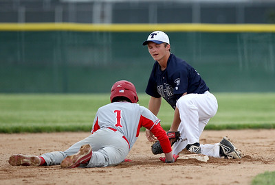 Sarah Nader - snader@shawmedia.com Cary-Grove's Matt Sutherland (right) waits for the pass while Barrington's Joey Sciaccotta safely slides back to second base Wednesday's Class 4A Jacobs Regional in Cary on May 22, 2013. Cary-Grove lost. 5-6.