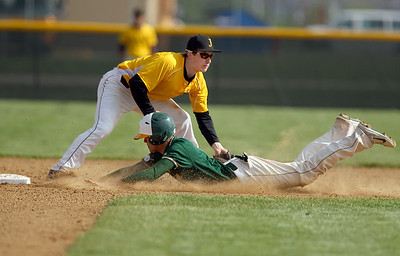 Sarah Nader - snader@shawmedia.com Jacobs' Grant Kale (left) waits for the ball while Crystal Lake South's Jake Bigos slides safely into second base during the first inning of Thursday's Class 4A Jacobs Regional in Algonquin on May 23, 2013. Jacobs won, 8-5.