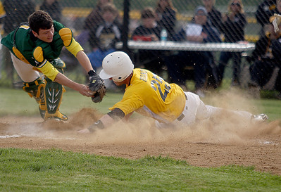 Sarah Nader - snader@shawmedia.com Crystal Lake South's Casey Oliver (left) is late to tag out Jacobs' Jon Berndt as he slides home during the third inning of Thursday's Class 4A Jacobs Regional in Algonquin on May 23, 2013. Jacobs won, 8-5.