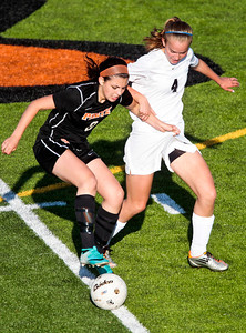 Kyle Grillot - kgrillot@shawmedia.com   Freeport sophomore Kirsten Pontius and Prairie Ridge sophomore Tatue Rae fight for the ball during the first half of the Class 2A Sectional at Freeport High School.