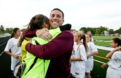 Kyle Grillot - kgrillot@shawmedia.com   Coach J.C. Brown and Prairie Ridge junior Brooke Laibly embrace after beating Freeport in the Class 2A Sectional at Freeport High School.