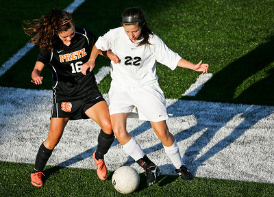 Kyle Grillot - kgrillot@shawmedia.com   Freeport senior Ali Reedy and Prairie Ridge junior Allyson Walsh fight for the ball during the second half of the Class 2A Sectional Friday at Freeport High School.