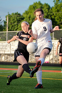 Kyle Grillot - kgrillot@shawmedia.com   Freeport sophomore Natalie Pontius and Prairie Ridge senior Kelsey Bear fight for the ball during the second half of the Class 2A Sectional at Freeport High School.