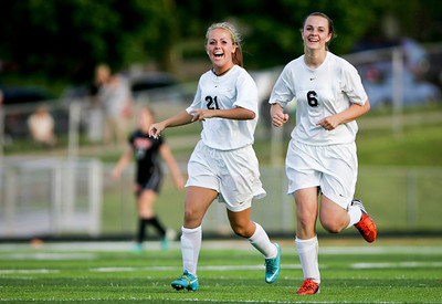 Kyle Grillot - kgrillot@shawmedia.com   Prairie Ridge junior Ali Fanning and Hallie Simons celebrate after a scored point during the first half of the Class 2A Sectional at Freeport High School.