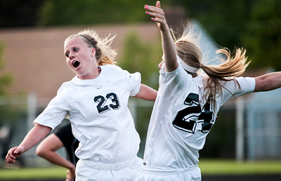 Kyle Grillot - kgrillot@shawmedia.com   Prairie Ridge seniors Allyson Walsh and Becca Hoklas celebrate after beating Freeport in the Class 2A Sectional at Freeport High School.