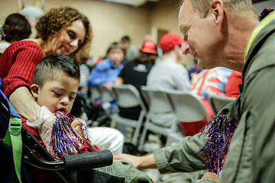 Lathan Goumas - lgoumas@shawmedia.com Retired United States Air Force Captain Gary Stec, of Woodstock, gives a red, white and blue streamer to Ali Munoz, 4, during a program honoring veterans and active military personnel at the Special Education District of McHenry County campus in Woodstock, Ill. on Friday, May 24, 2013.