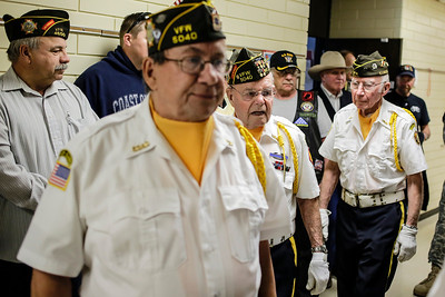Lathan Goumas - lgoumas@shawmedia.com Members of the Veterans of Foreign Wars Post 5040 and other veterans enter the gym at the Special Education District of McHenry County campus in Woodstock, Ill. during a program honoring veterans and active military personnel on Friday, May 24, 2013.