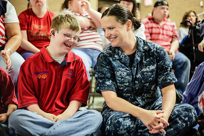 Lathan Goumas - lgoumas@shawmedia.com United States Navy Hospital Corpsman Third Class Kylee Thompson talks with Logan Blyth, 10, during a program honoring veterans and active military personnel at the Special Education District of McHenry County campus in Woodstock, Ill. on Friday, May 24, 2013.