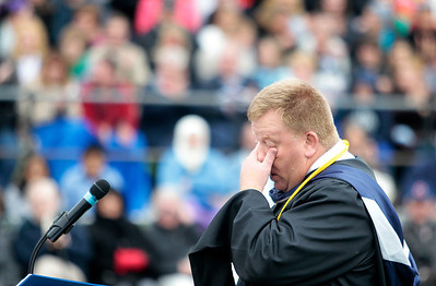 Kyle Grillot - kgrillot@shawmedia.com   Principal Jay Sergeant wipes away tears as he presents the class of 2013 during the Cary-Grove High School commencement Saturday at Al Bohrer Athletic Field.