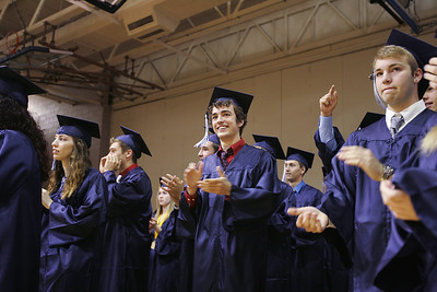 Kyle Grillot - kgrillot@shawmedia.com   Cary-Grove faculty is cheered on by the graduates as they pass through the gymnasium before the start of the Cary-Grove High School commencement Saturday at Al Bohrer Athletic Field.