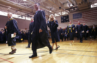 Kyle Grillot - kgrillot@shawmedia.com   Cary-Grove faculty pass through the gymnasium before the start of the Cary-Grove High School commencement Saturday at Al Bohrer Athletic Field.