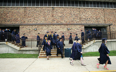 Kyle Grillot - kgrillot@shawmedia.com   Students walk from the gymnasium before the start of the Cary-Grove High School commencement Saturday at Al Bohrer Athletic Field.