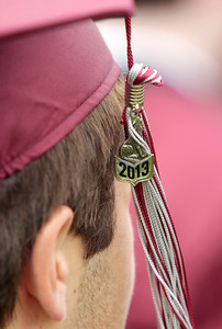 Kyle Grillot - kgrillot@shawmedia.com   A student waits while the diplomas are presented during the Prairie Ridge High School commencement Saturday at the Prairie Ridge football field.