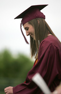 Kyle Grillot - kgrillot@shawmedia.com   Kelsey Bear is congratulated by the class of 2013 after giving her welcome during the Prairie Ridge High School commencement Saturday at the Prairie Ridge football field.