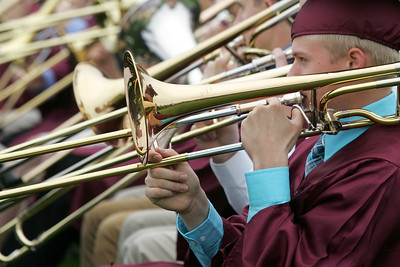Kyle Grillot - kgrillot@shawmedia.com   Ryan Wayman plays the trombone with the rest of the band during the Prairie Ridge High School commencement Saturday at the Prairie Ridge football field.