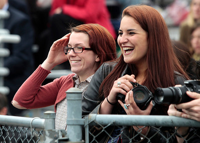Kyle Grillot - kgrillot@shawmedia.com   Jesica O'Shea and Hannah Famolaro laugh after screaming for graduate Fancesca Famolaro during the Prairie Ridge High School commencement Saturday at the Prairie Ridge football field.