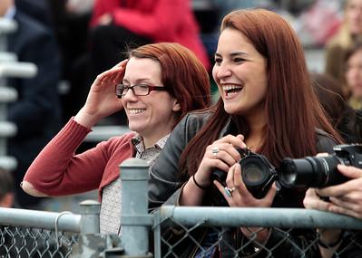 Kyle Grillot - kgrillot@shawmedia.com   Jesica O'Shea and Hannah Famolaro laugh after screaming for graduate Fancesca Famolaro during the Prairie Ridge High School commencement Saturday at the Prairie Ridge football field.