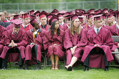 Kyle Grillot - kgrillot@shawmedia.com   Seniors wait for the start of the presentation of diplomas during the Prairie Ridge High School commencement Saturday at the Prairie Ridge football field.