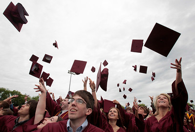 Kyle Grillot - kgrillot@shawmedia.com   The class of 2013 toss their hats after the Prairie Ridge High School commencement Saturday at the Prairie Ridge football field.