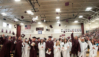 Kyle Grillot - kgrillot@shawmedia.com   Graduates throw their caps during the Marengo Community High School commencement on Sunday, May 26, 2013.
