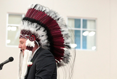 Kyle Grillot - kgrillot@shawmedia.com   Principal Scott Shepard is given an headdress as a gift from the class of 2013 before his speech during the Marengo Community High School commencement on Sunday, May 26, 2013.