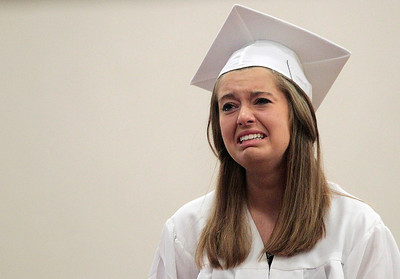 Kyle Grillot - kgrillot@shawmedia.com   Class President Lauren Grossen become emotional while walking across the stage to receive her diploma during the Marengo Community High School commencement on Sunday, May 26, 2013.