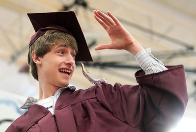Kyle Grillot - kgrillot@shawmedia.com   Graduate Christopher Rahn salutes the crowd as he walks across the stage during the Marengo Community High School commencement on Sunday, May 26, 2013.