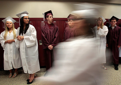 Kyle Grillot - kgrillot@shawmedia.com   Graduates gather in the hallways before the start of the Marengo Community High School commencement on Sunday, May 26, 2013.