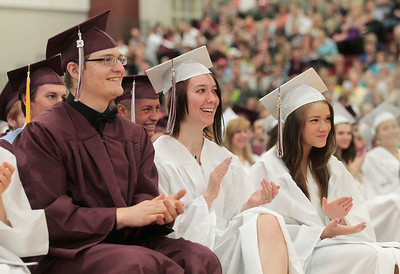 Kyle Grillot - kgrillot@shawmedia.com   Graduates laugh after Valedictorian Jessica Villie gives her speech during the Marengo Community High School commencement on Sunday, May 26, 2013.