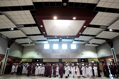 Kyle Grillot - kgrillot@shawmedia.com   Graduates wait to enter the gymnasium before the start of the Marengo Community High School commencement on Sunday, May 26, 2013.