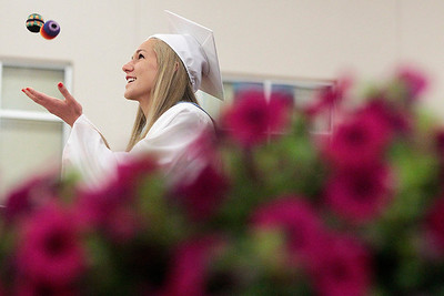 Kyle Grillot - kgrillot@shawmedia.com   Valedictorian Jessica Villie decided she would do something she may never have the chance to do again, juggle while giving a speech during the Marengo Community High School commencement on Sunday, May 26, 2013.