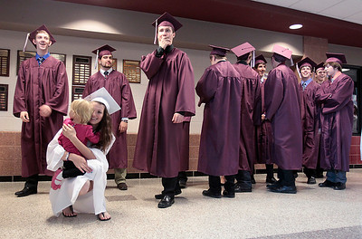 Kyle Grillot - kgrillot@shawmedia.com   Graduate Danielle Kaleta says bye to her daughter Ann Marie Kaleta as she waits to enter the gymnasium before the start of the Marengo Community High School commencement on Sunday, May 26, 2013.