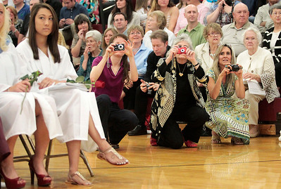 Kyle Grillot - kgrillot@shawmedia.com   Spectators take pictures from the side of the graduates during the Marengo Community High School commencement on Sunday, May 26, 2013.