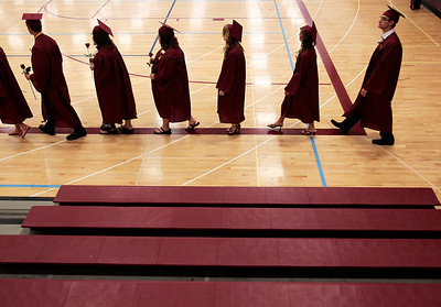 Kyle Grillot - kgrillot@shawmedia.com   Graduates enter the gymnasium before the start of the Richmond-Burton Community High School commencement on Sunday, May 26, 2013.