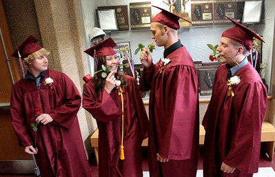 Kyle Grillot - kgrillot@shawmedia.com   Graduates Charlie Glavin, Jasmine Garner, James Galla, and Rudiger Freiberger fool around before the start of the Richmond-Burton Community High School commencement on Sunday, May 26, 2013.
