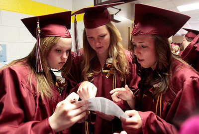 Kyle Grillot - kgrillot@shawmedia.com   Graduates Kira Hewlett, Andrea Fox, and Jasmine Garner look to find where they are supposed to be before the start of the Richmond-Burton Community High School commencement on Sunday, May 26, 2013.