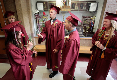 Kyle Grillot - kgrillot@shawmedia.com   Graduates Charlie Glavin, Jasmine Garner, James Galla, Rudiger Freiberger, and Andrea Fox  fool around before the start of the Richmond-Burton Community High School commencement on Sunday, May 26, 2013.