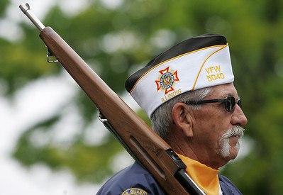 Kyle Grillot - kgrillot@shawmedia.com   VFW 5040 Commander Mark Freund waits for the start of the Woodstock Memorial Day parade at Woodstock Square Monday, May 27, 2013.