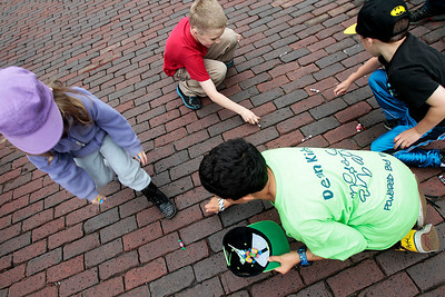Kyle Grillot - kgrillot@shawmedia.com   Children pick up candy during the Woodstock Memorial Day parade at Woodstock Square Monday, May 27, 2013.