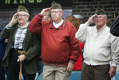 Kyle Grillot - kgrillot@shawmedia.com   Devere Harmon, Lloyd Freund, and Harry Smith all salute the flag before the start of the Johnsburg Memorial Day parade Monday, May 27, 2013.