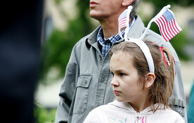 Kyle Grillot - kgrillot@shawmedia.com   Madison Kniola ,10, of Woodstock listens to Vietnam veteran John Hansen give a speech before the start of the Woodstock Memorial Day parade at Woodstock Square Monday, May 27, 2013.